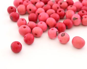 10 round beads pink in 6-10mm Acai seeds