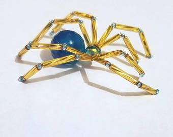 Glass beaded spider figurine - blue and gold