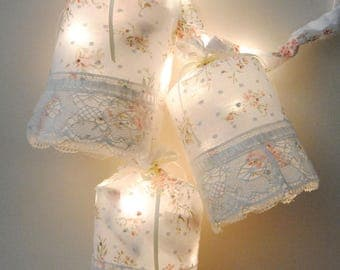 Three lamps with floral decoration