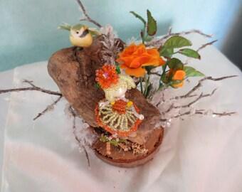 Child's room decor: small GNOME and bird.