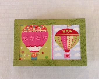 Born in cardboard gift box, fabric decoration balls and light green leatherette