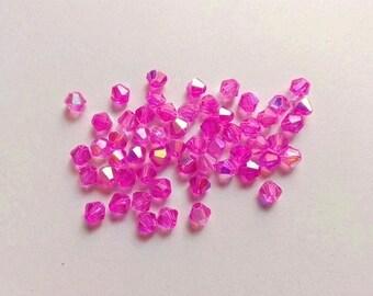 40 beads 3mmx4mm iridescent fuchsia glass bicone