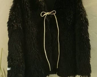 Girl furry fleece and Black sleeveless vest.
