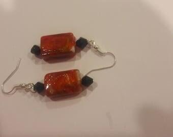 orange square with black beaded earrings