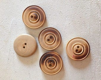 Old round wooden buttons