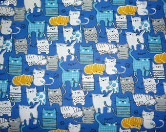 Fabric C584 grey/blue/white cats on blue coupon 35x50cm