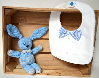 White bib with blue bow tie