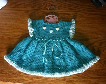 Hand crocheted baby dresses