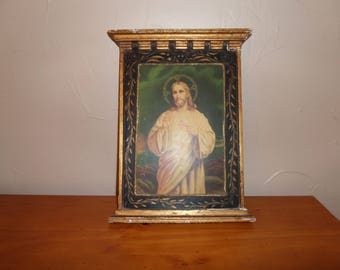 Old religious wooden frame and plaster Christian