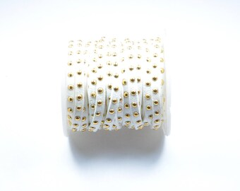 CO118 - 1 metre of white suede cord with studs gold plated
