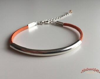 Orange suede bracelet, silver metal tube