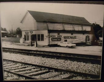 Black & White Picture of Store Near Train Tracks