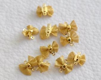 2 connectors gold color bow