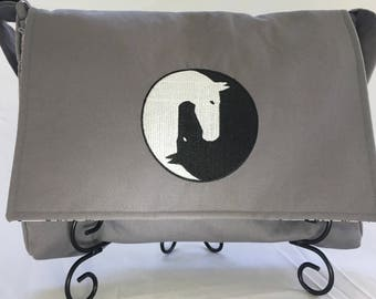 Messenger bag with embroidered ying yang horse