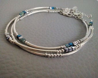 Thin tubes and silver beads bracelet