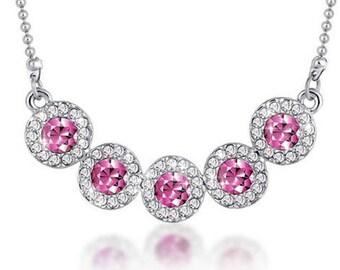 Collier argenté cristal à facette rose et chaine argenté.