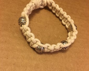 Cord bracelet adorned with tube beads