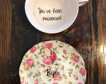 "You've been poisoned. | Vulgar tea cup with coordinating ""Bye."" saucer"