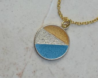 Small circle pendant with bright blue and yellow colour details - charm - geometric