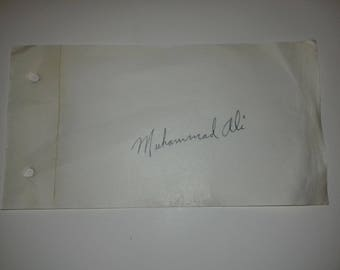 Mohammad Ali , (aka Cassius Clay) signed autograph book page 1960s boxing collectable memorabilia