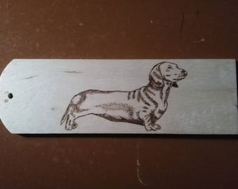 Hand-burned bookmark: dachshund. Pyrography.