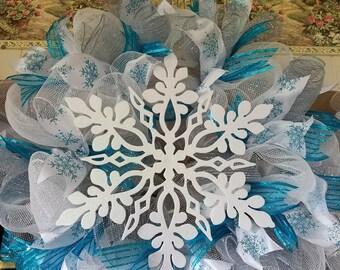 Teal and white deco mesh Snowflake wreath