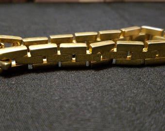 Linked bracelet gold tone bracelet