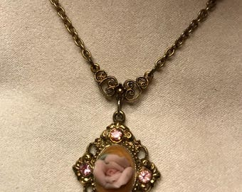 Lovely girls necklace with pink sparkles and rose pendant.