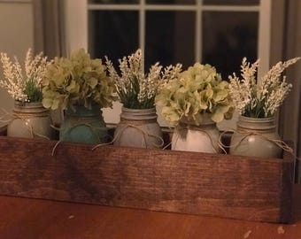 wooden table box with mason jars and flowers