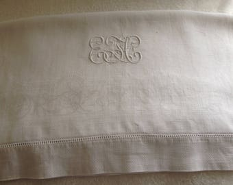 Antique linen damask towel in white finished with a hem stitched border and a beautiful EFC monogram