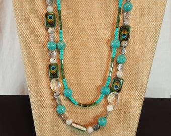 Double strand necklace in shades of turquoise with clear glass beads