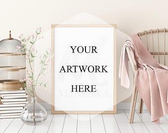 Wood portrait frame mockup, livingroom light wood frame mockup, vertical frame wicker chair, natural lighting, modern frame mockup