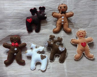Reindeer and gingerbread man in felt. Christmas tree Decorations