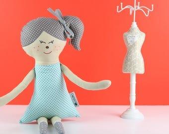 Handmade doll wearing a dress