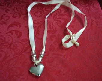 Vintage silver tone heart charm on ribbon necklace.