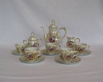 """Vintage """"Couple Courting"""" Tea Set with Five Cups and Saucers with Gold Accent"""