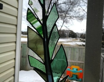 Large stained glass feather.