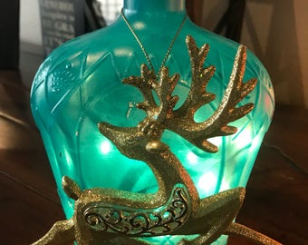 Lighted glass bottle decor   Adds beautiful ambiance to any room