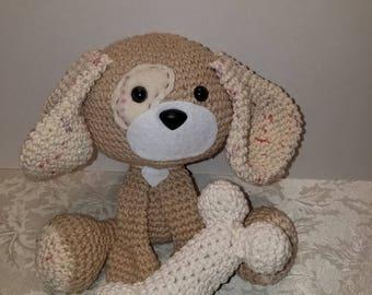 Amigurumi crocheted puppy with bone