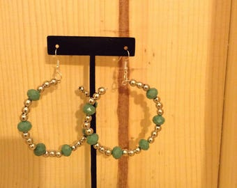 Large silver and fire polished green bead earrings