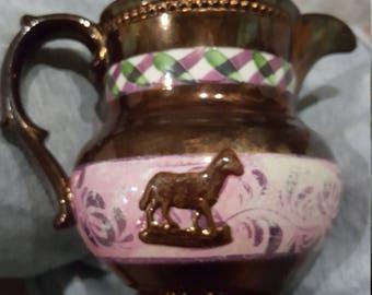Antique copper pitcher
