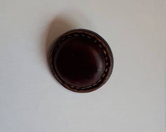 Leather effect button