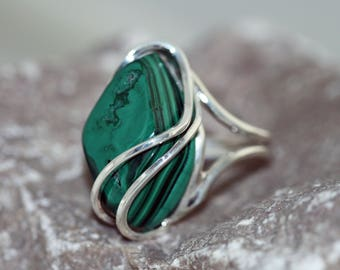 Malachite Ring. Originally shaped piece of Malachite with characteristic patterns on top and sides. Handmade & unique. Ring is adjustable.