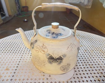 Old beautifully decorated teapot