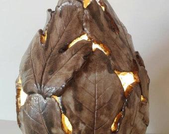 Glazed terracotta lamp.
