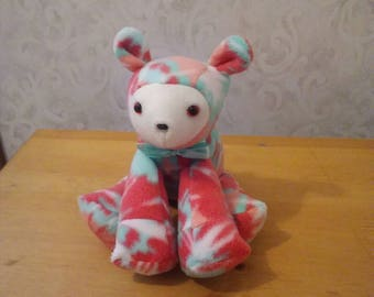 Lamb for baby nursery. Fleece peach n mint green. Hypoallergenic stuffing. Safety lock eyes n nose. Measures 10 inches long.