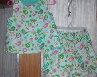Girls 3T reversible top. Cotton springtime friends with snap back. Shorts lined. Up to 20.50 waist