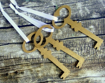 Gold key wood Christmas tree ornaments or modern country present decoration / gift toppers. White ribbon. Set of 3.