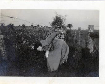 vintage photo 1920 Woman Cornfield Gets Stuck Going thru Barbed Wire Fence bent over