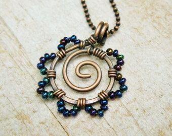 Iris Blue Seed Bead Flower Necklace - Hammered Copper Swirl center with Iris Blue seed bead petals pendant necklace